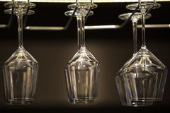 Wineglasses. Glasses of wine in rack Stock Images