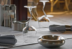 Wineglasses and ashtray in restaurant Stock Photography