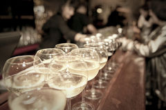 Wineglasses on bar counter Stock Photography