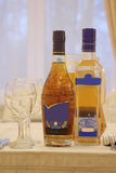 Wineglasses and bottles of alcohol Stock Photo