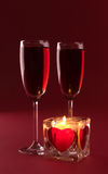 Wineglasses and candle on the white background Stock Photos