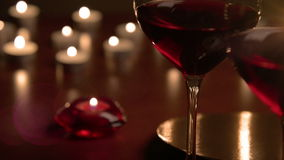 Wineglasses in candlelight stock video