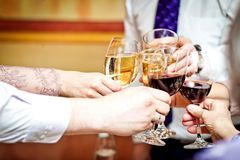 Wineglasses in a celebration clink Royalty Free Stock Image