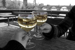 Wineglasses with Charles Bridge on backgraund. Prague, Czech Republic Royalty Free Stock Photography