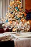 Wineglasses and Christmas tree in background Stock Image