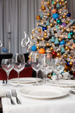 Wineglasses and Christmas tree in background Stock Photo