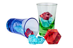 Wineglasses with colored ice pieces Stock Images