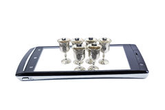 Wineglasses on the display of smartphone. Collage Royalty Free Stock Photos