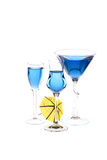 Wineglasses are filled with blue beverage Stock Image