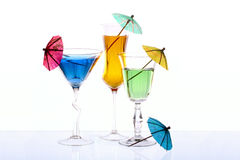 Wineglasses are filled with colored beverages Royalty Free Stock Photography