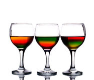 Wineglasses filled with multicolored cocktail Royalty Free Stock Photography