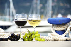 Wineglasses and grapes Stock Images