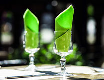 Wineglasses and napkins Stock Photos