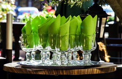 Wineglasses and napkins. Ready for dinner in cafe royalty free stock images