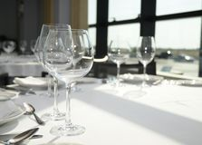 Wineglasses and plates on tablle Stock Photo
