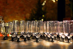 Wineglasses and pouring wine on holiday reception table taken cl Stock Images