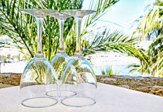 Wineglasses prepared on outdoors table Stock Photos
