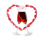 Wineglasses with red wine inside a heart shape Stock Images