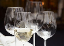 Wineglasses on restaurant table Stock Image