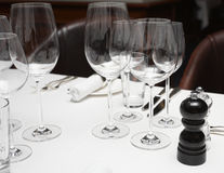 Wineglasses on restaurant table Stock Images
