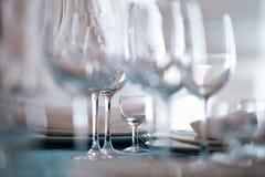Wineglasses. Small glass among large Stock Photo