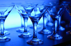 Wineglasses on the table in blue Royalty Free Stock Photos