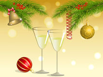 Wineglasses under Christmas tree. Two glasses of wine under the branches of a Christmas tree, decorated with balls, bell, streamers and berries against the Royalty Free Stock Photo