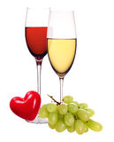 Wineglasses with white and red wine, heart and grape isolated Royalty Free Stock Images