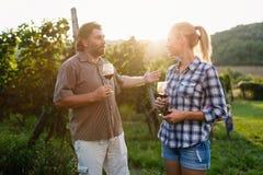 Winegrower family tasting wine Royalty Free Stock Photo