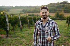 Winegrower tasting wine in vineyard Stock Images