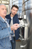 Winegrowers serving wine Royalty Free Stock Photos