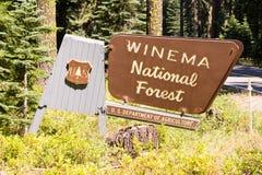 National Forest Sign Boundary Winema Public Use Land. The Winema National Forest sign is leaning forward stock photos