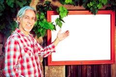 Winemaker With Billboard Stock Foto