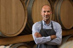 Winemaker in cellar royalty free stock image