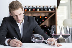 Winemaker examining a wine glass Stock Images