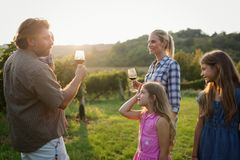 Winemaker family together in vineyard. Winemaker family happy together in vineyard before harvesting royalty free stock photo