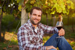 Winemaker with a glass of red wine Stock Photo