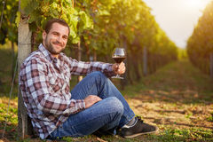 Winemaker with a glass of red wine Royalty Free Stock Photo