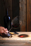 Winemaker's hand with glass Royalty Free Stock Photography