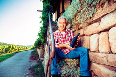Winemaker Sitting By His Cottage Royalty Free Stock Photo