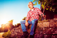 Winemaker Sitting By His Vineyard Royalty Free Stock Photography