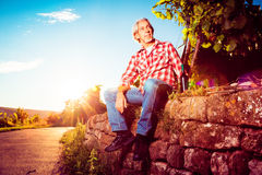 Winemaker Sitting By His Vineyard Stock Photography