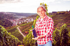Winemaker Standing By His Vineyard. Holding bottle of wine stock photo