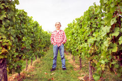 Winemaker Standing By His Vineyard Royalty Free Stock Photos