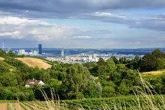 Grinzing is a suburb of Vienna. Grape gardens in the hills and views of Vienna at sunset stock photography