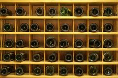 Winerack. A rack full of winebottles in a winecellar Royalty Free Stock Image