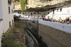 Wineries built into rock overhangs. Setenil is a small town located in Cadiz, Andalusia. It has a distinctive setting along a narrow river gorge Royalty Free Stock Images