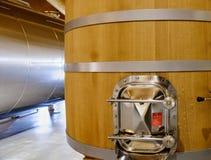 Wineries of La Rioja in Spain. Detail of the metal emptying door of a wooden drum to ferment wine with metal rings in a winery d la Rioja in Spain stock photo