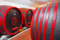 Winery. Old wooden barrels for wine storage, photography Stock Image