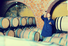 Winery employee with glass of wine Royalty Free Stock Images